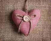 Heart with button on on brown sacking