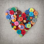 Colorful buttons heart on sacking