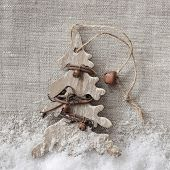 Wooden christmas tree on fabric background