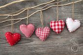 Red hearts on wooden background