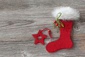 Christmas stocking on wooden background