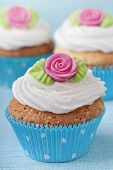 Cup cakes with pink marzipan rose