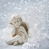 Angel statue on silver background