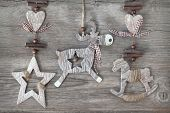 Wooden christmas deer,star and rocking horse on wooden background