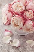 foto of bunch roses  - Pink roses and petals on wooden desk - JPG