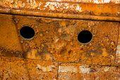 Rusty wall of an abandoned ship