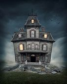 stock photo of midnight  - Haunted house on the empty field - JPG