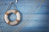stock photo of life-boat  - Life buoy decoration on blue shabby background - JPG