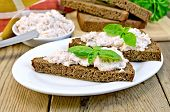 Sandwiches With Cream Of Salmon And Mayonnaise On The Board