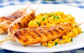 Honey chicken skewers with grilled corn salad