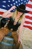 """stock photo of barrel racing  - Bring your fourth of July together with our patroitic sexy cowgirl in """"Stars and Stripes forever"""" ** Note: Slight graininess, best at smaller sizes - JPG"""