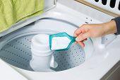 Putting Soap Into Washing Machine