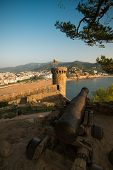 Old canon against Villa Vella fortress view