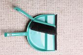 Green Sweeping Brush And Dustpan On Floor - Housework