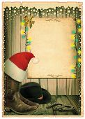 Cowboy Christmas Background With Santa Hat And Antique Paper For Text