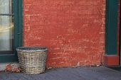 Rustic red brick wall and basket