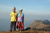 Hill tribe couple in colorful traditional style T-shirt, Mae Hong Son