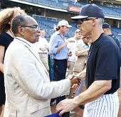 BRONX, NY-JUNE 1; Supercentenarian Bernando LaPallo, who is 111 years old, shakes hands with New Yor