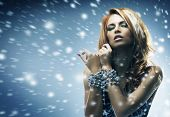 foto of redheaded  - Glamour portrait of beautiful girl over the winter background - JPG