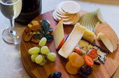 image of fruit platter  - Overhead view of a cheese and fruit platter with sparkling wine - JPG