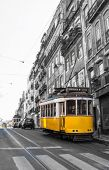 Yellow Tram in motion, Lisbon, Portugal