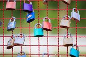 key lock on steel net fence with shallow depth of field