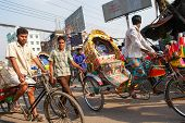 DHAKA, BANGLADESH - MARCH 25, 2009: Traditionally ornamented cycle rickshaws presents a very practic