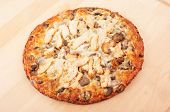 Chicken Pizza On Wooden Cutting Board