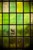 Colored Stained Glass Window With Regular Block Pattern Green Tone