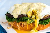image of benediction  - Vegetarian eggs benedict made with gouda cheese steamed kale sauteed portobello mushroom - JPG