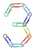 Paperclips Arranged Into The Shape Of The Number 3.