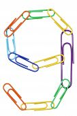 Paperclips Arranged Into The Shape Of The Number 9.