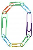 Paperclips Arranged Into The Shape Of The Letter O Or The Number 0.