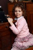 The little girl in  an vintage interior