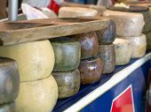 Forms Of Italian Pecorino Cheese On A Table In A Fair