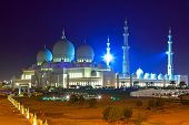 stock photo of eastern culture  - Grand Mosque in Abu Dhabi at night - JPG