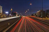Atlanta, Georgia, USA - February 15, 2014:  Night freeway traffic in midtown Atlanta speeding towards downtown towers.