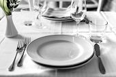 table setting in restaurant interior, desaturated