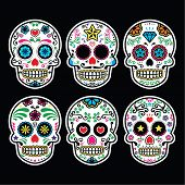 Mexican sugar skull, Dia de los Muertos icons set on black background