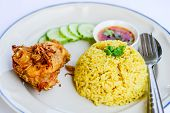 Yellow Rice With Fried Chicken On Dish