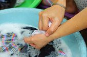 picture of wench  - hands washing in enameled bowl close up