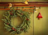 Old Pair Of Skis Hanging With Wreath