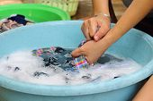 stock photo of wench  - hands wash in enameled bowl close up