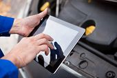 Car Mechanic Using Digital Tablet