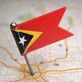 East Timor Small Flag on a Map Background.