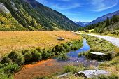 Headwaters Krimml waterfalls. Hillsides picturesque alpine valley covered with thick coniferous fore