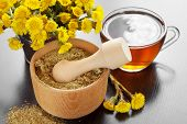 Mortar, Pestle And Bucket With Coltsfoot Flowers