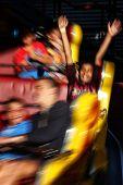 Happy boy on a funfair ride