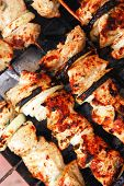 healthy shish kebab - ready grill barbecue chicken turkish meat on skewers over charcoal brazier out
