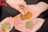 Human Handsgiving And Receiving Golden Coins